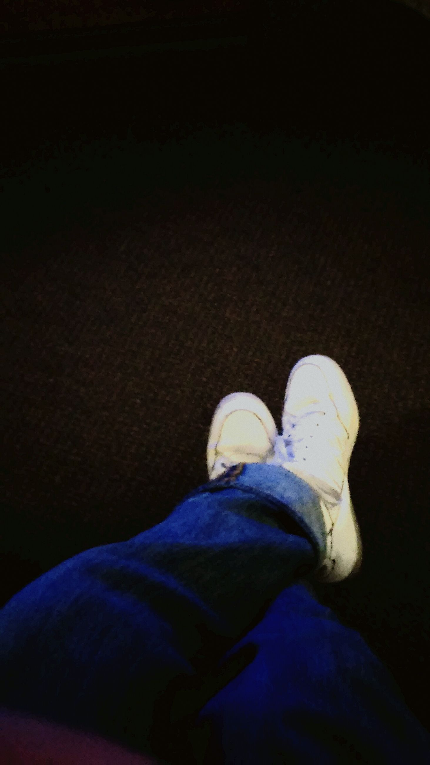 low section, person, shoe, jeans, lifestyles, personal perspective, casual clothing, standing, men, leisure activity, indoors, human foot, high angle view, relaxation, footwear, blue, sitting