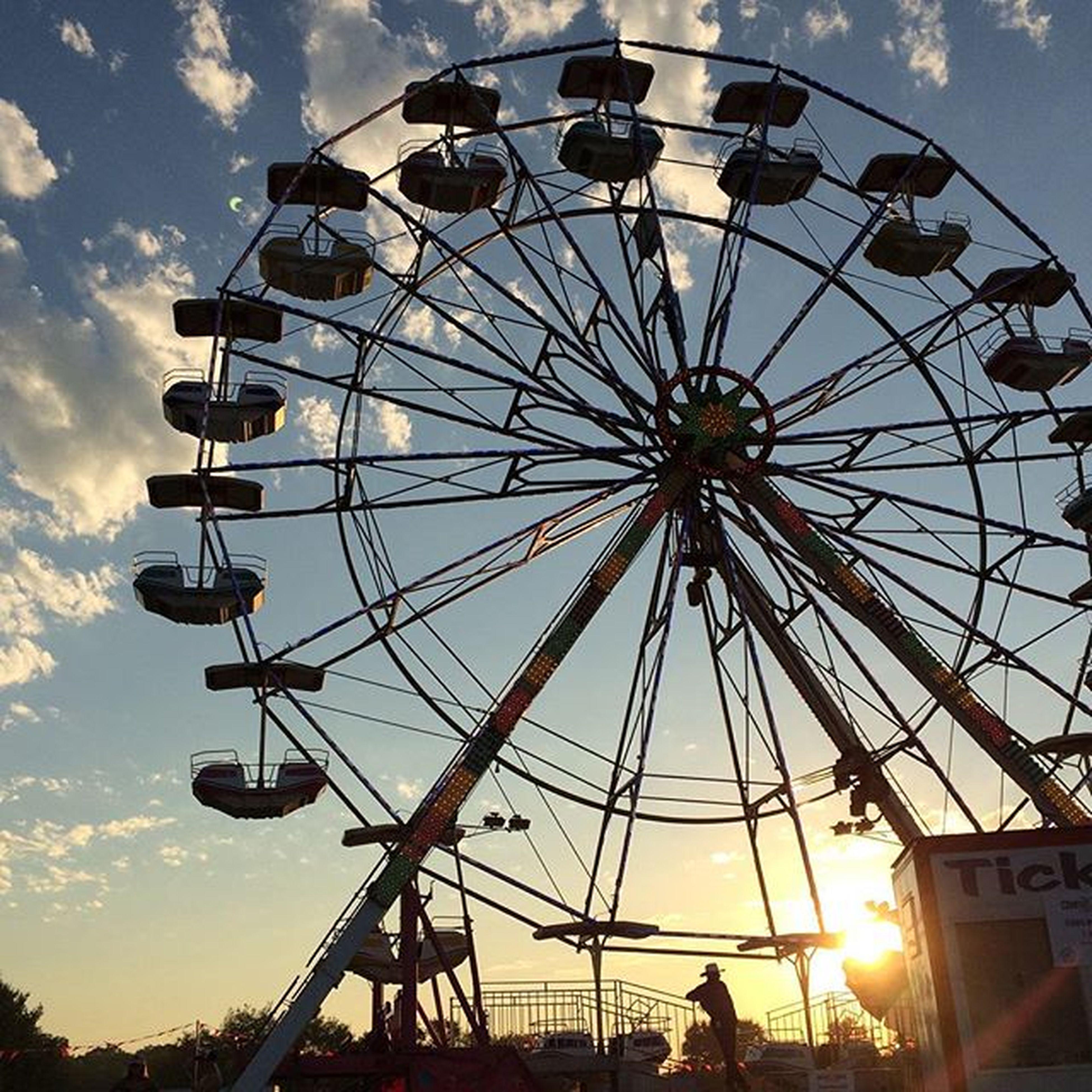 ferris wheel, amusement park, amusement park ride, low angle view, arts culture and entertainment, sky, cloud - sky, silhouette, leisure activity, enjoyment, built structure, fun, architecture, incidental people, cloud, outdoors, sunset, large, sunlight