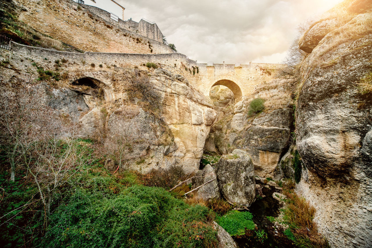 View of Ronda Bridge and canyon. Ronda is a beautiful city in the province of Malaga, Spain. Ancient Architecture Andalusia Beauty In Nature Canyon Cliffs Cloudy Day Costa Del Sol Famous Place Guadalevin History Landmark Landscape Malaga Nature Outdoors Picturesque Village Rocky Mountains Ronda Bridge Ronda Spain SPAIN Stunning Scenery Sun Town Travel Destinations Village