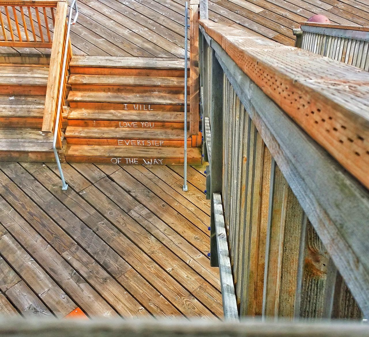 High Angle View Of Wooden Stairs With Text