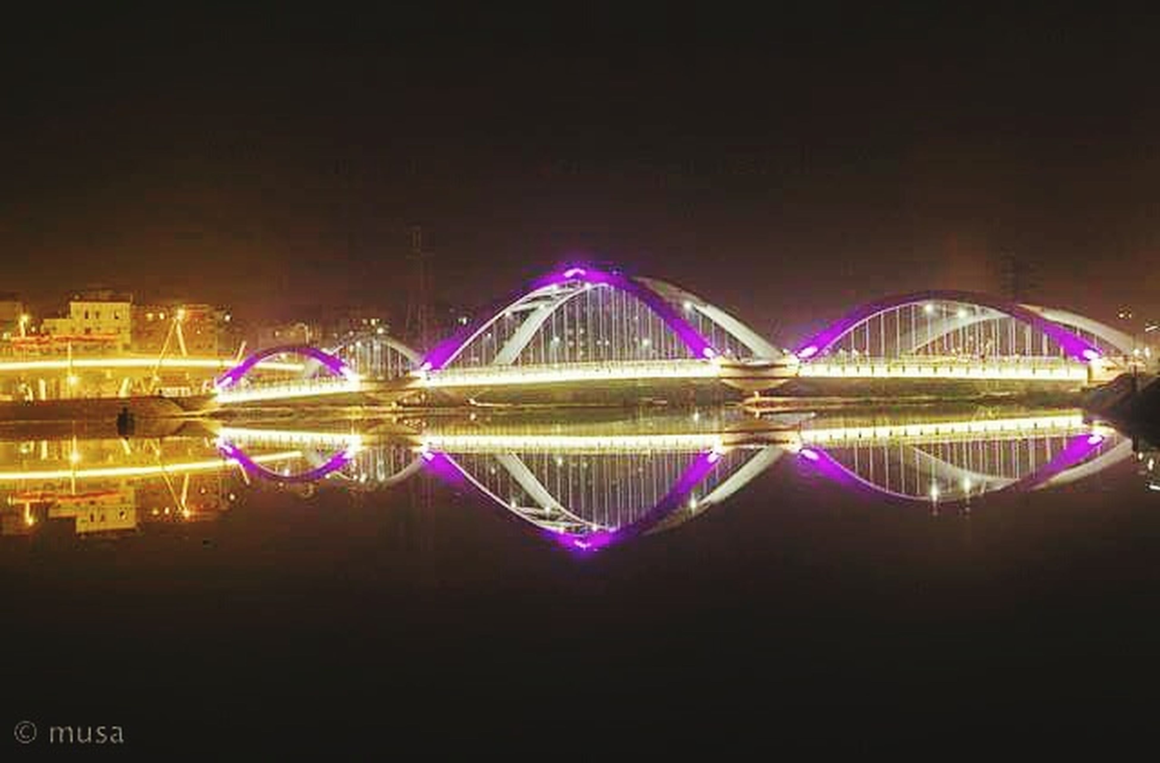 night, reflection, illuminated, city, igniting, ferris wheel, connection, sky, architecture, water, bridge - man made structure, no people, cityscape, outdoors