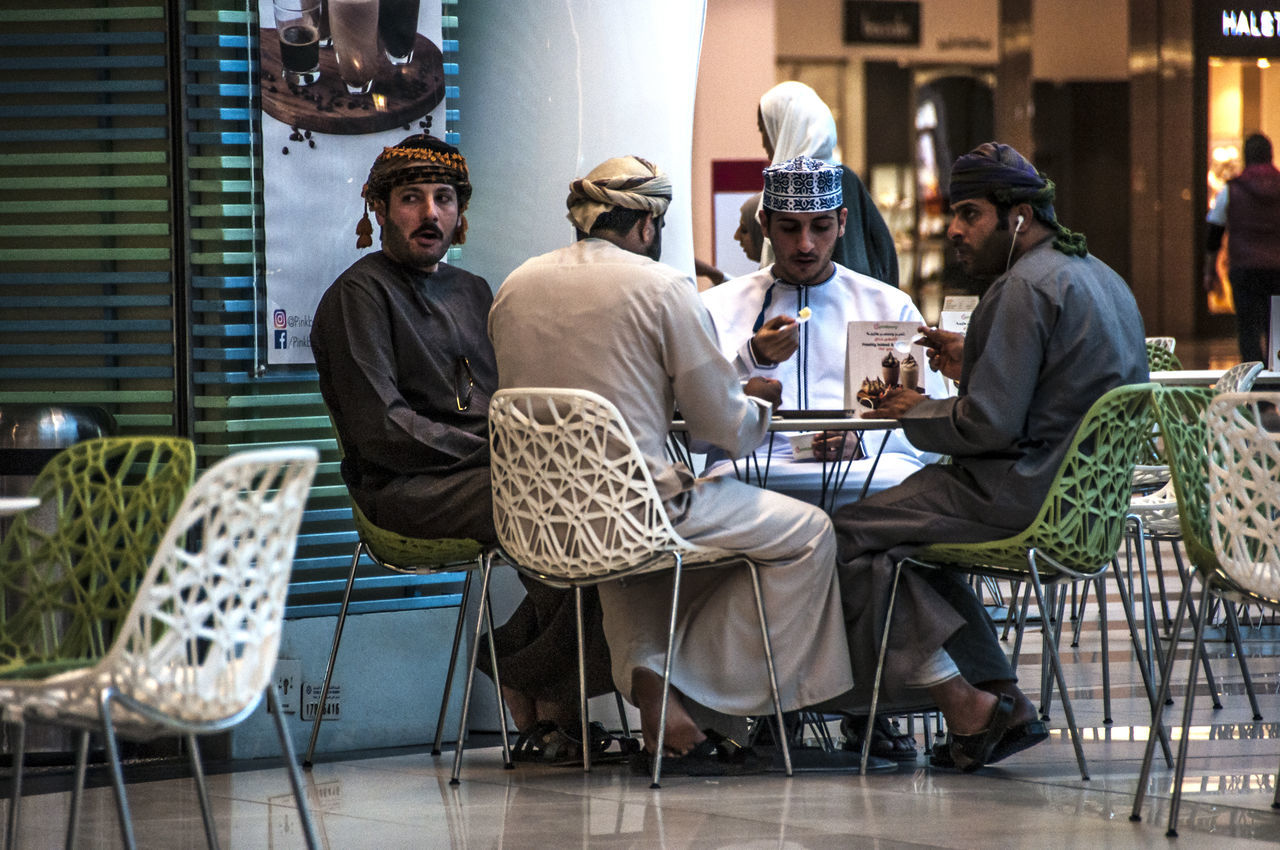In the coolness of the mall, some ice cream to revive taste and soul... Friendship Ice Cream Ice Cream Time Mall Moments Moments Of Life Ordinary  The Street Photographer - 2017 EyeEm Awards Togetherness Traditional Clothing