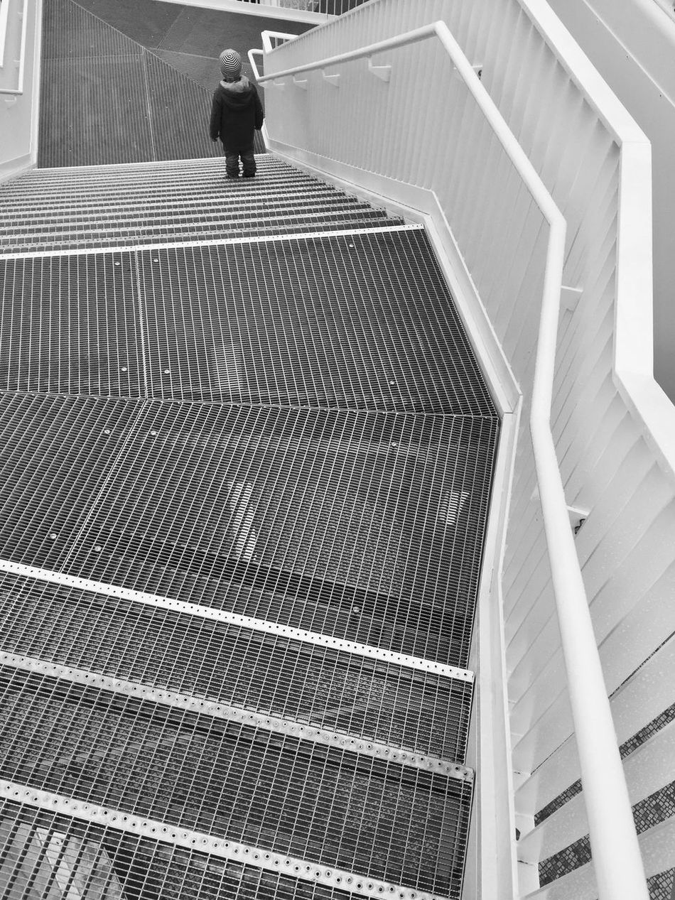 Steps And Staircases Staircase Steps Real People Walking One Person Pattern Built Structure Lifestyles Leisure Activity Boy Stairs Urban Geometry Urban Day Solar Energy Architecture