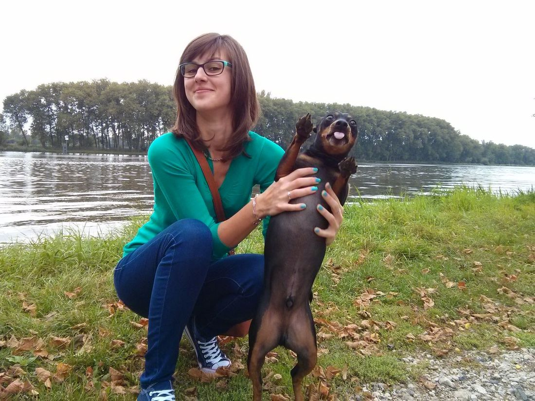 Derp Face on Dog while taking photo with Girlfriend