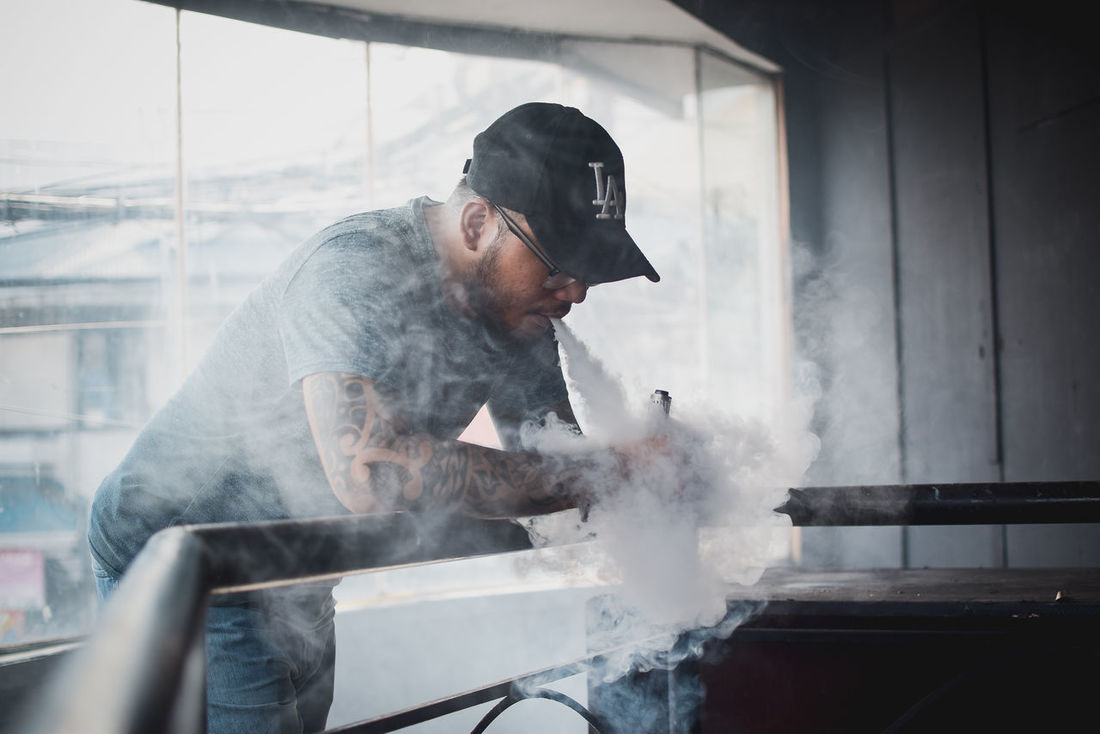 Vaping is a lifestyle Cap Day Freshness Holding Indoors  One Person Preparation  Real People Smoke - Physical Structure Vacations VapeLife Vapelifestyle VSCO Vscophile Vscophileph EyeEmNewHere Let's Go. Together.