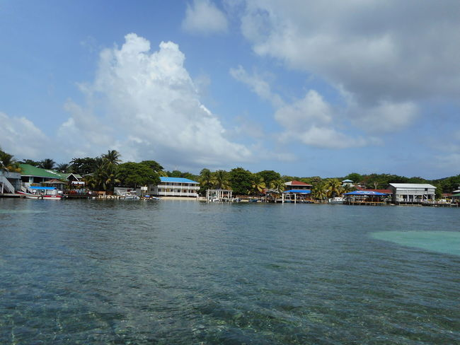 Honduras Roatan Architecture Bay Islands Beauty In Nature Building Exterior Built Structure Cloud - Sky Day Nature Nautical Vessel No People Outdoors Scenics Sea Sky Tranquility Transportation Tree Water Waterfront