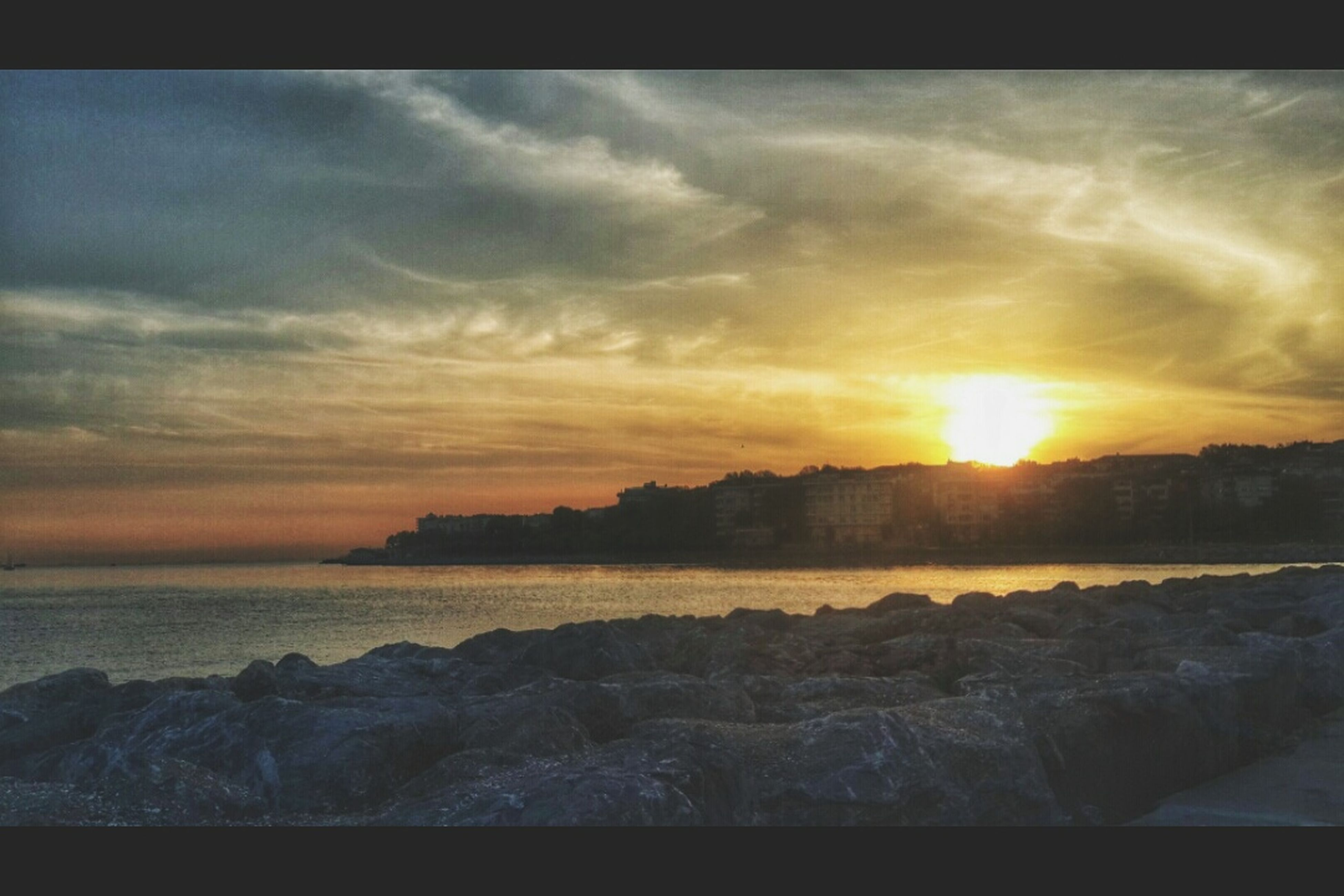 sunset, water, sky, scenics, cloud - sky, beauty in nature, tranquil scene, sea, tranquility, sun, orange color, nature, idyllic, rock - object, transfer print, cloud, cloudy, auto post production filter, sunlight, horizon over water
