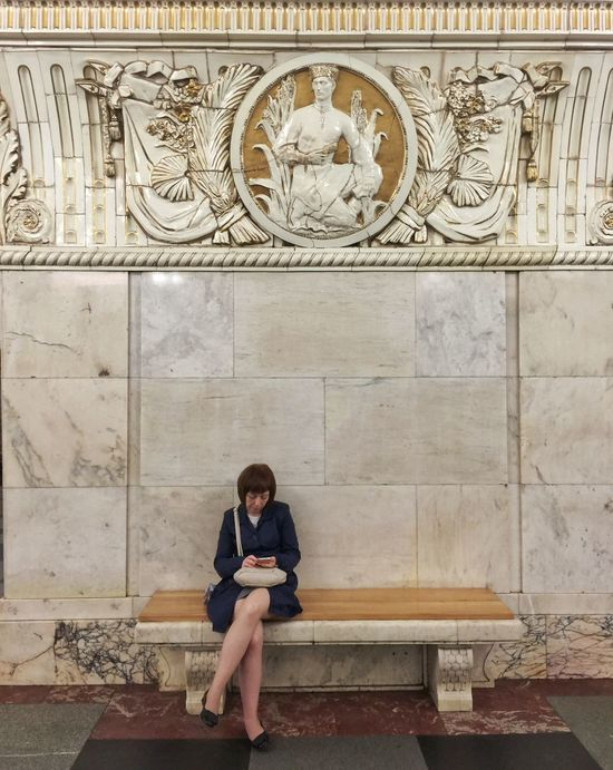A woman checks her phone while waiting for the metro at Prospekt Mira metro Streetphotography Traveling Rus2015tc Metro