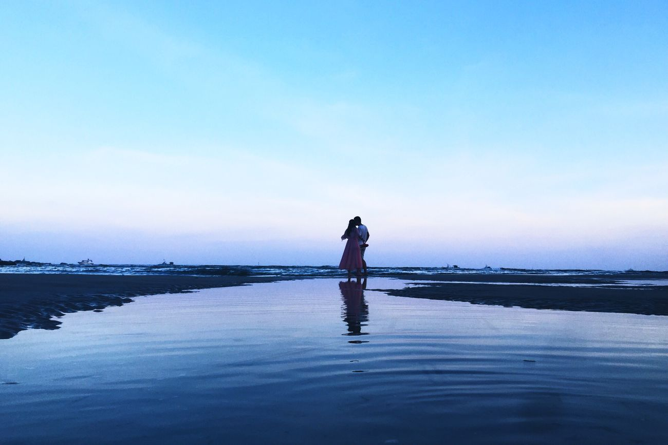 DONGSHAN ISLAND- 旅志 Water Reflection Standing Silhouette Tranquil Scene Tranquility Scenics Sea Sky Solitude Vacations Blue Nature Getting Away From It All Beauty In Nature Day Waterfront Person Tourism