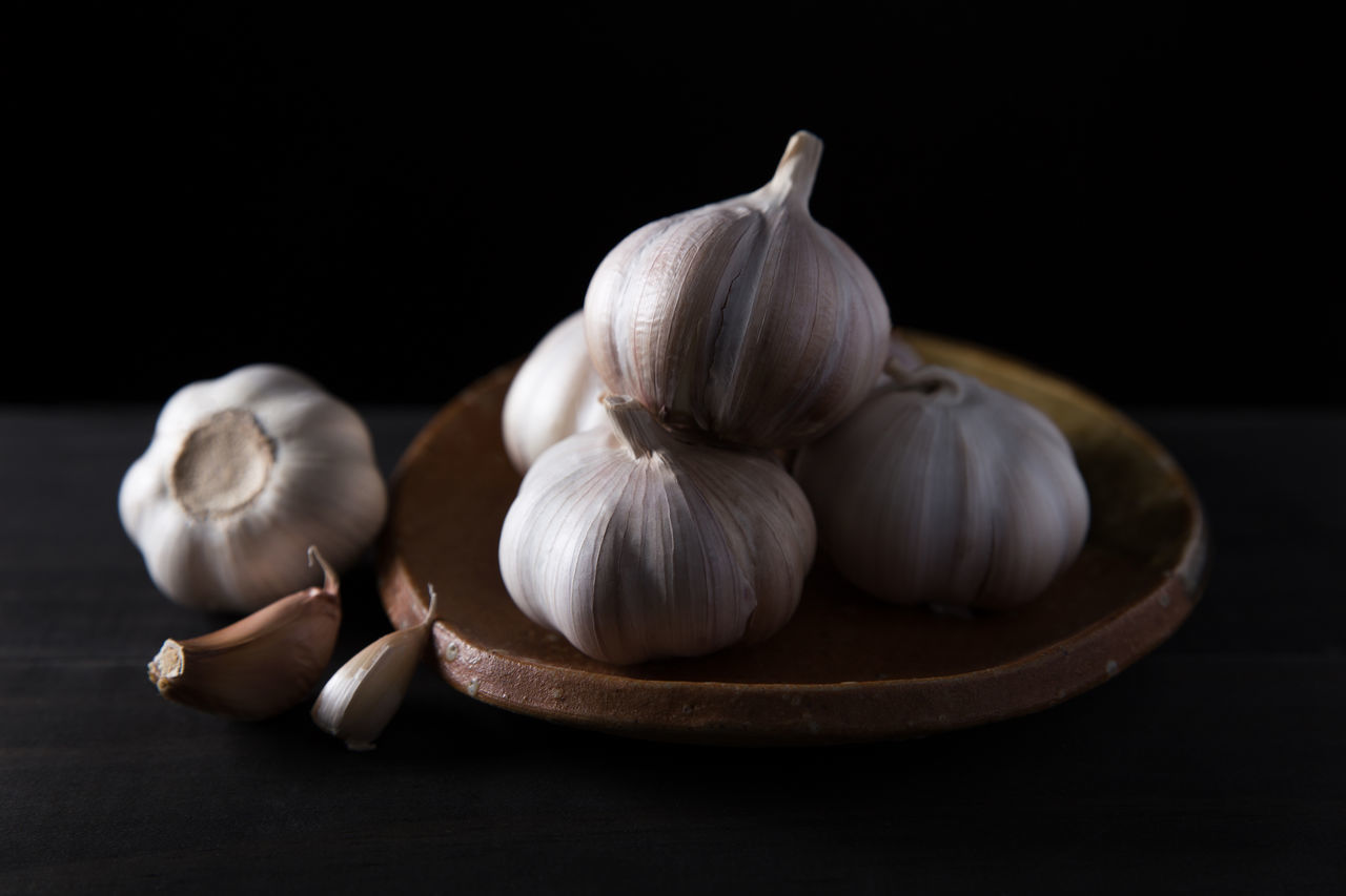 Garlic cloves Aromatic Black Background Close-up Cuisine Food Food And Drink Fresh Freshness Garlic Garlic Bulb Garlic Clove Healthy Eating Herb Ingredient No People Organic Food Plant Raw Raw Food Ripe Spice Studio Shot Table Vegetable Vegetarian Food