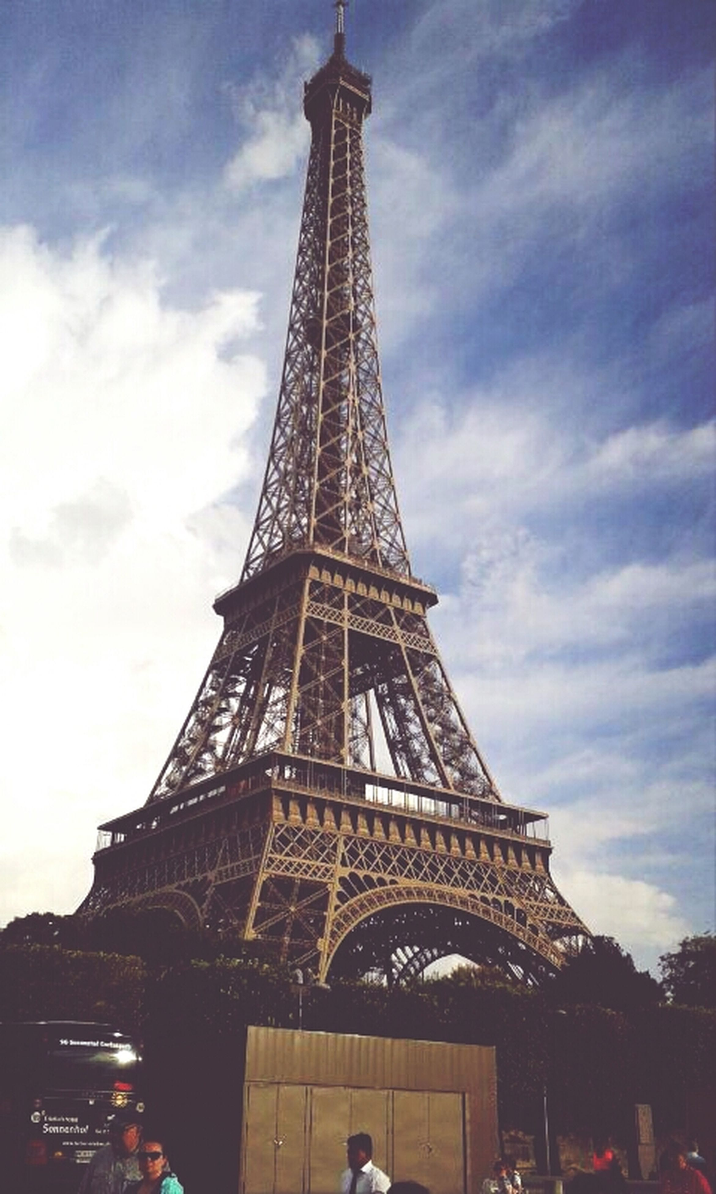 eiffel tower, architecture, famous place, built structure, international landmark, tower, travel destinations, tourism, tall - high, capital cities, sky, travel, culture, low angle view, history, building exterior, city, cloud - sky, architectural feature, metal