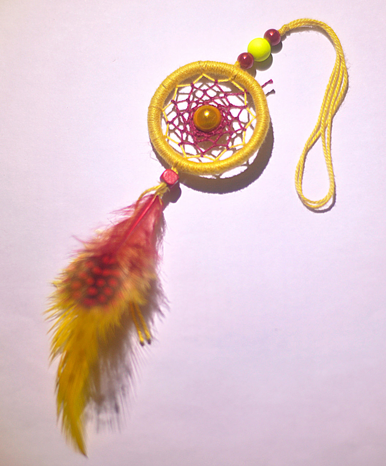 "In some Native American cultures, a dreamcatcher (or dream catcher; Lakota: iháŋbla gmunka, Ojibwe: asabikeshiinh, the inanimate form of the word for ""spider"" or Ojibwe: bawaajige nagwaagan meaning ""dream snare"") is a handmade object based on a willow hoop, on which is woven a loose net or web. Catcher Charm Dream Dreamcatcher Luck Pink Web Yellow First Eyeem Photo"