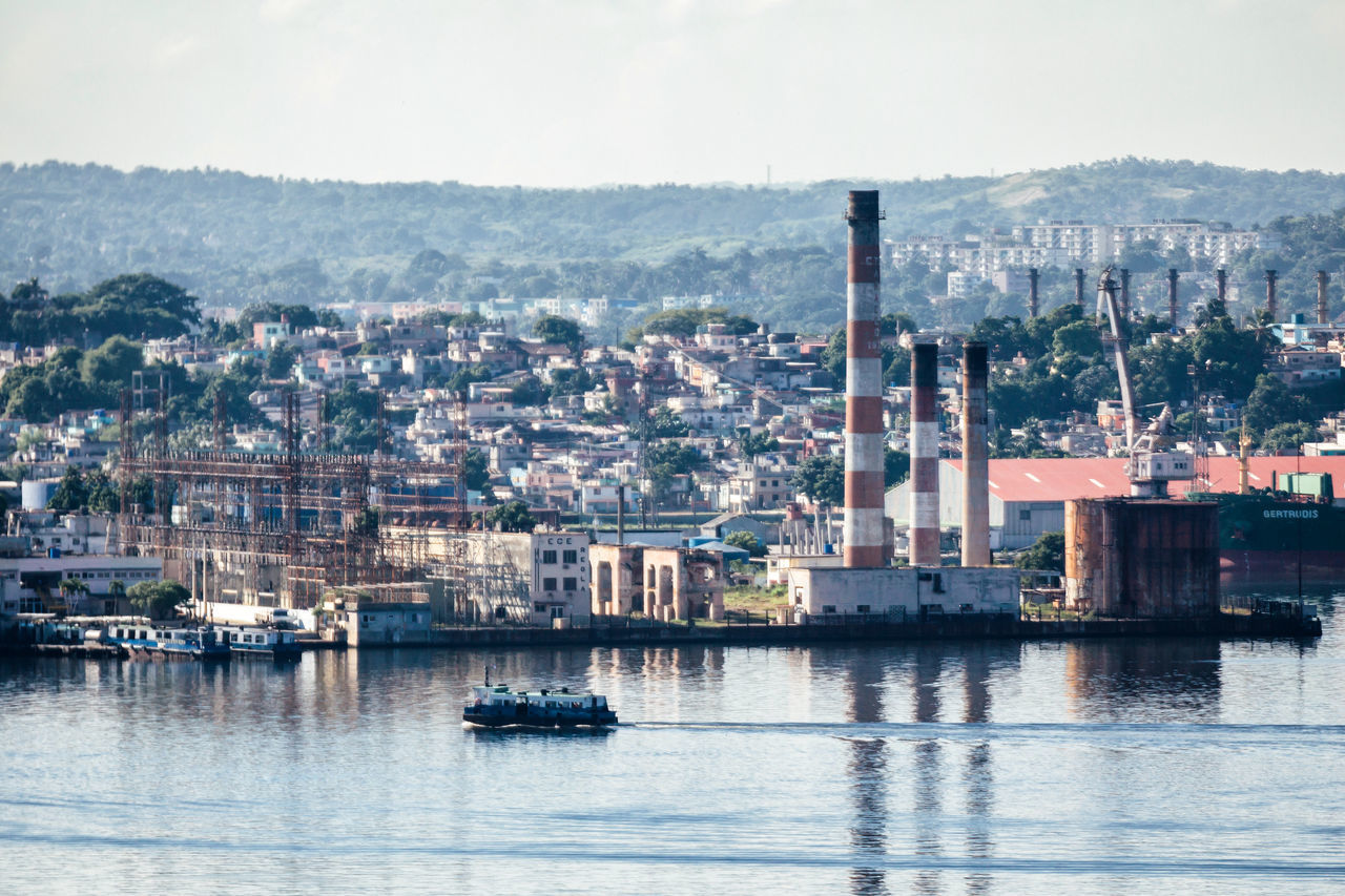 Architecture Boat Building Exterior Built Structure City Cityscape Commercial Dock Cuba Collection Cuban Life Factory Harbor Industry Mountain Nature Nautical Vessel No People Outdoors Sea Sky Water