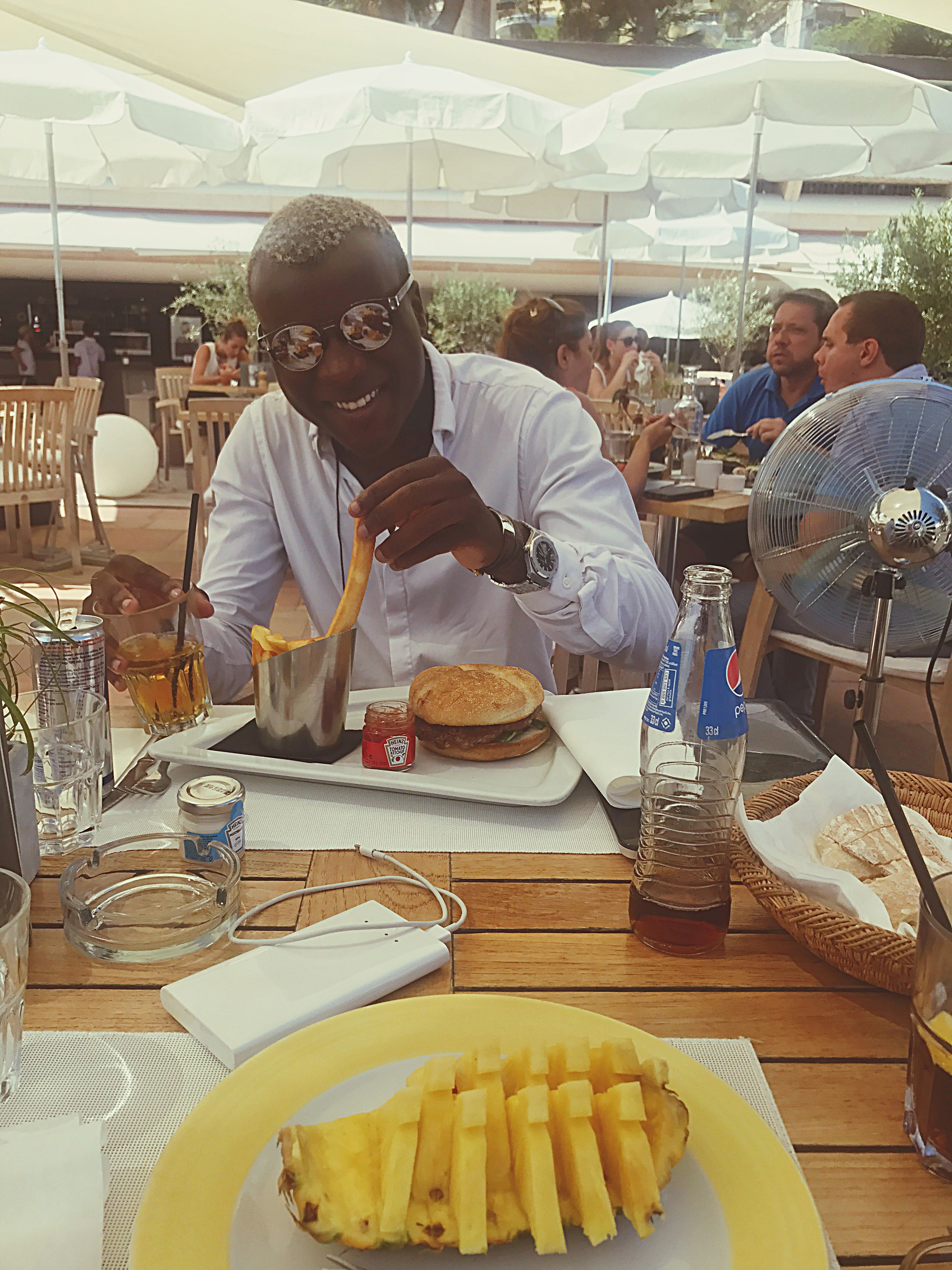 food and drink, real people, restaurant, table, food, plate, cafe, men, drink, lifestyles, indoors, one person, freshness, day, people