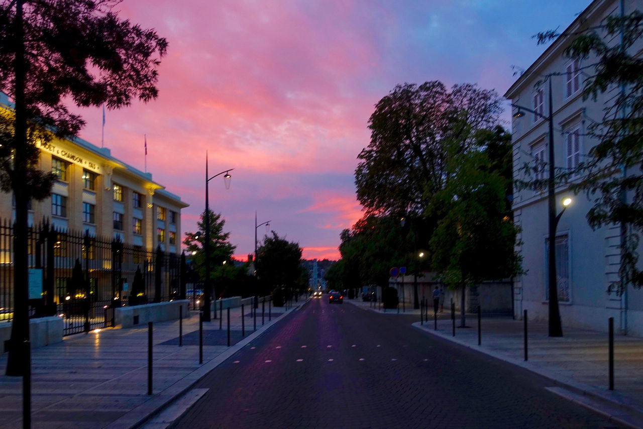 The Avenue de Champagne in Épernay, France. Architecture Avenue De Champagne Building Exterior Built Structure City City Street Cloud - Sky Dusk Epernay France Outdoors Pink Color Road Sky Sunset Tree