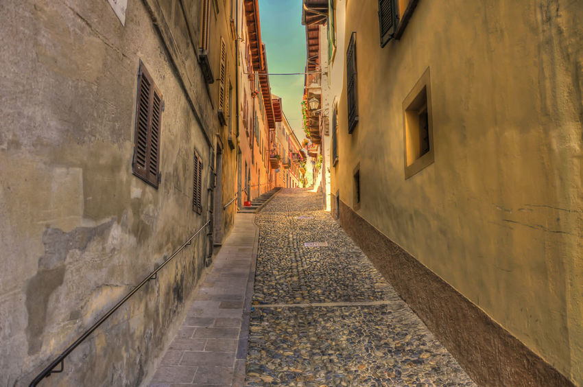 Narrow Street in Old Town in Cannobio, Italy. Narrow Old Town Street Culture Sunlight Sunny Architecture Building Exterior Built Structure City Colofrul Colorful Day Diminishing Perspective Famous Place No People Outdoors Street The Way Forward Town Travel Destinations Vanishing Point Walkway