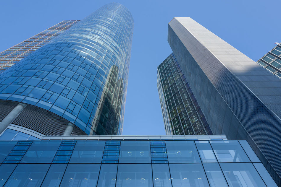 Frankfurt Skyscraper Architecture Building Exterior Built Structure Business Business Finance And Industry City City Life Cityscape Clear Sky Downtown District Façade Financial District  Futuristic Glass - Material Low Angle View Maintower Modern No People Office Building Exterior Outdoors Place Of Work Reflection Sky Skyscraper Tower