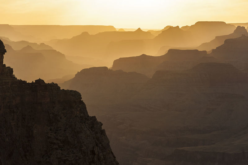 Grand Canyon, view from south rim at sunset. Geology Grand Canyon Landscape Misty Evening Mountains Nationalpark Silhouette South Rim Sunset USA Warm Colors Warm Light Landscapes With WhiteWall Landscape With Whitewall The Great Outdoors With Adobe