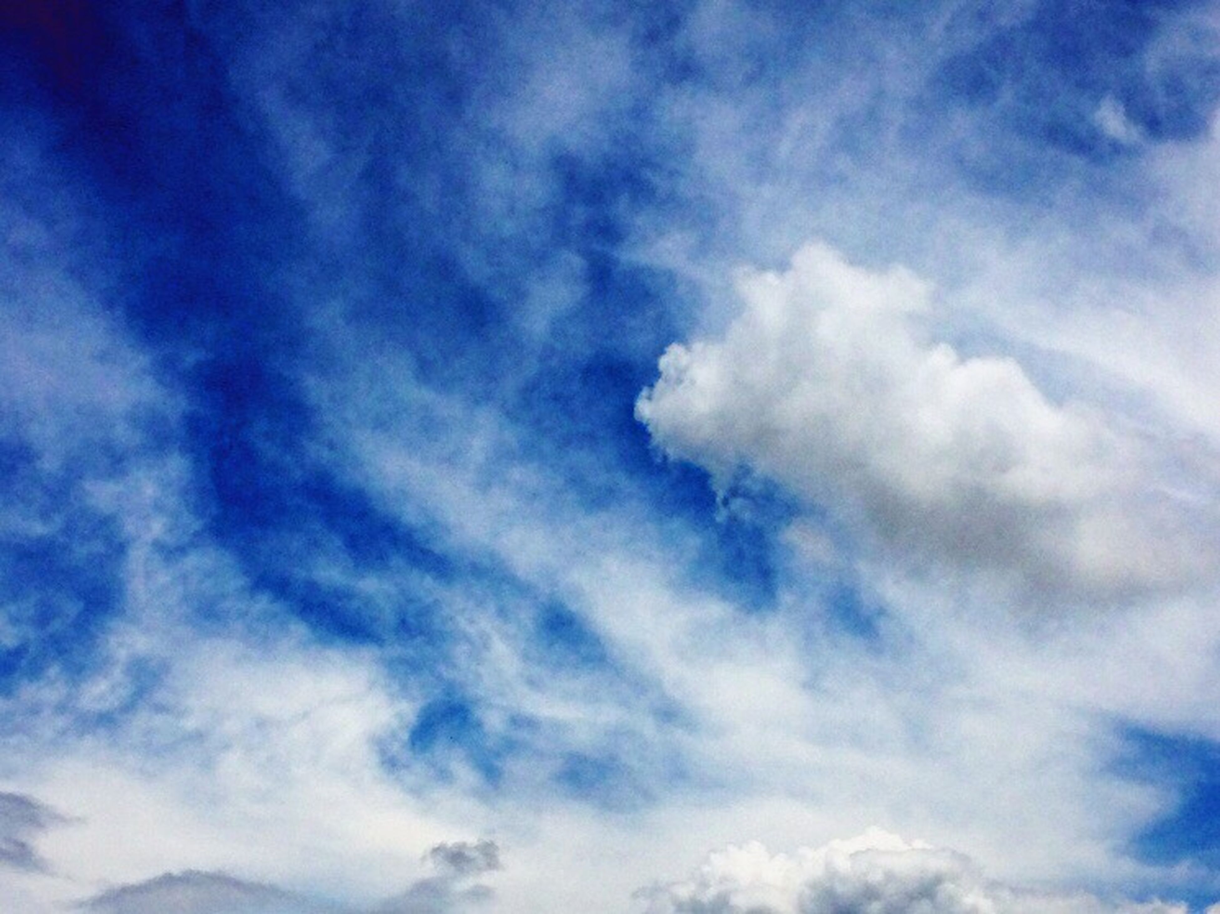 low angle view, sky, blue, cloud - sky, sky only, beauty in nature, tranquility, nature, scenics, cloudy, cloud, cloudscape, backgrounds, white color, tranquil scene, outdoors, day, no people, full frame, idyllic