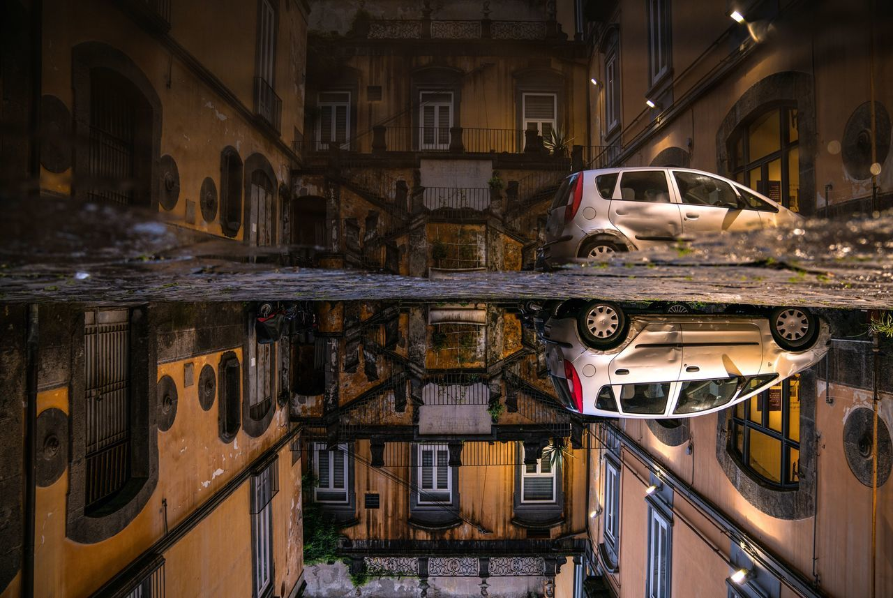 A plunge into another dimension. Built Structure Architecture Night City Building Exterior Napoli Travel Destinations Naples City Italy❤️ Bella Italia Italy Italia Street Photography Streetphotography Architecture Reflection Water Reflections Upside Down Europe Traveling Travel