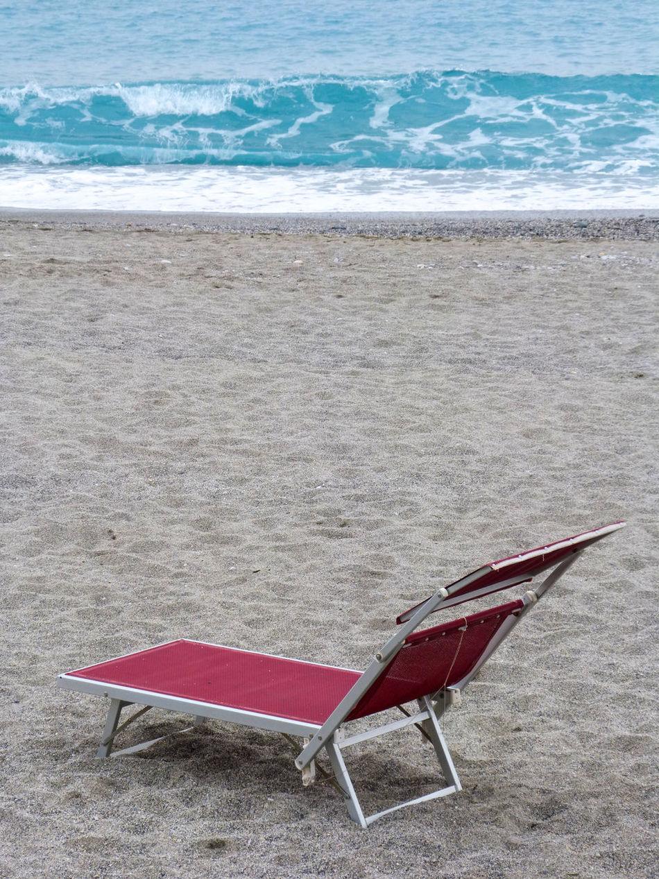 Red sunbed Beach Sand Sea Shore Outdoors Water Wave Nature Sunbed Sunchair Sand Beach Liguria Italy Scenics