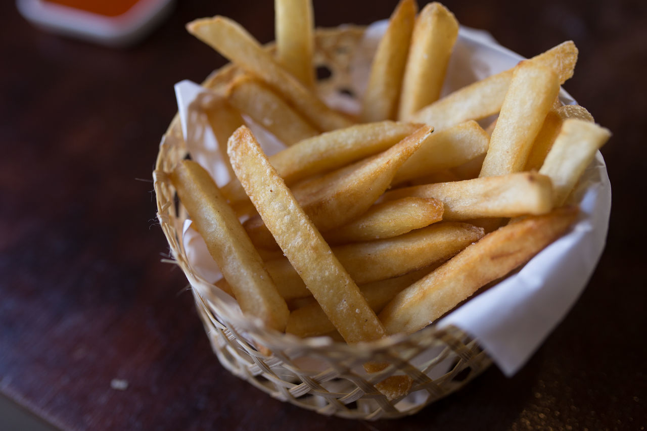 french fries, unhealthy eating, prepared potato, basket, deep fried, food and drink, fast food, food, take out food, fried food, fried, close-up, high angle view, ready-to-eat, snack, freshness, dip, relish, ketchup, indulgence, table, indoors, no people, temptation, wax paper, paper plate, day
