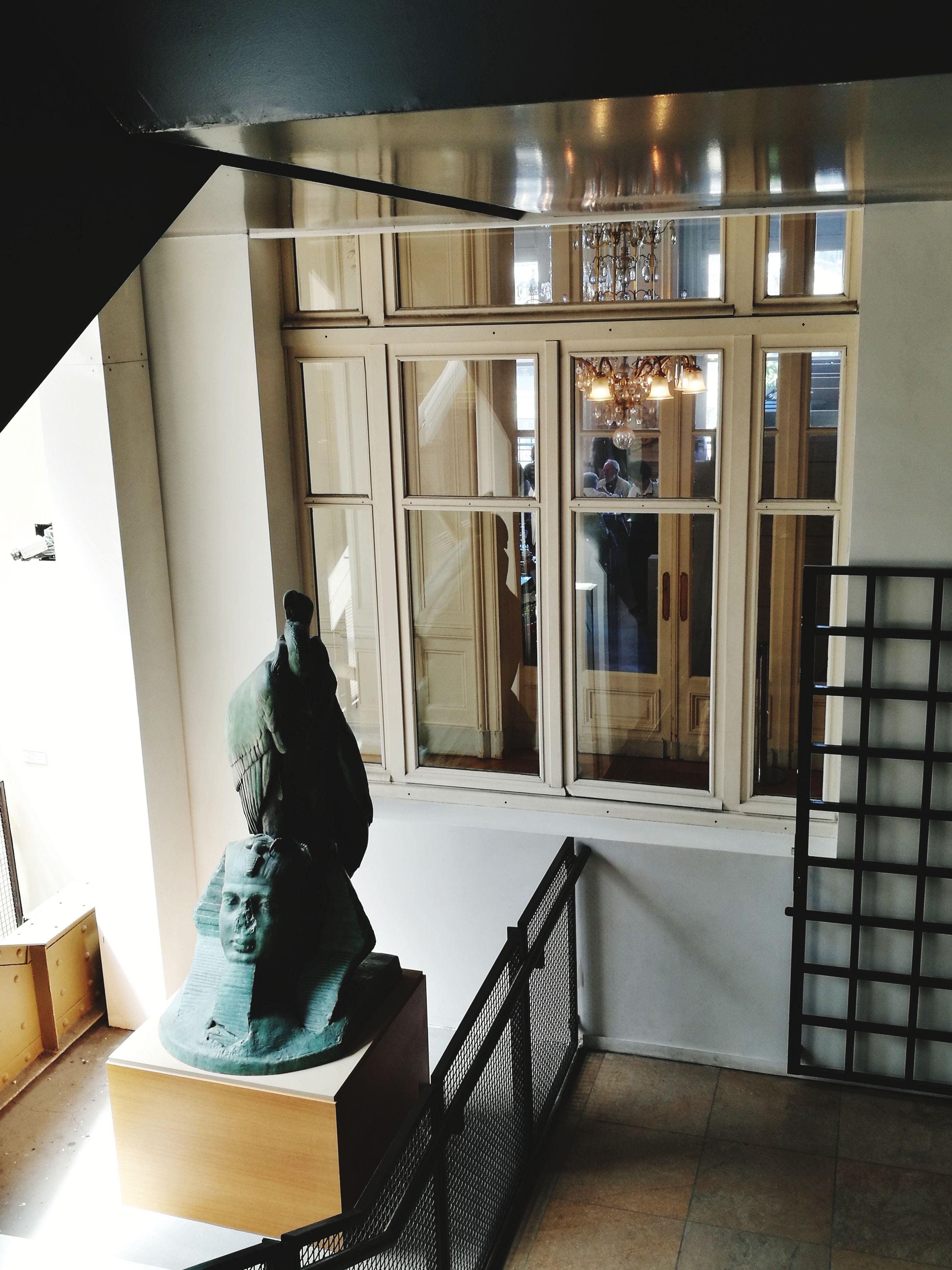 indoors, window, statue, illuminated, night, no people