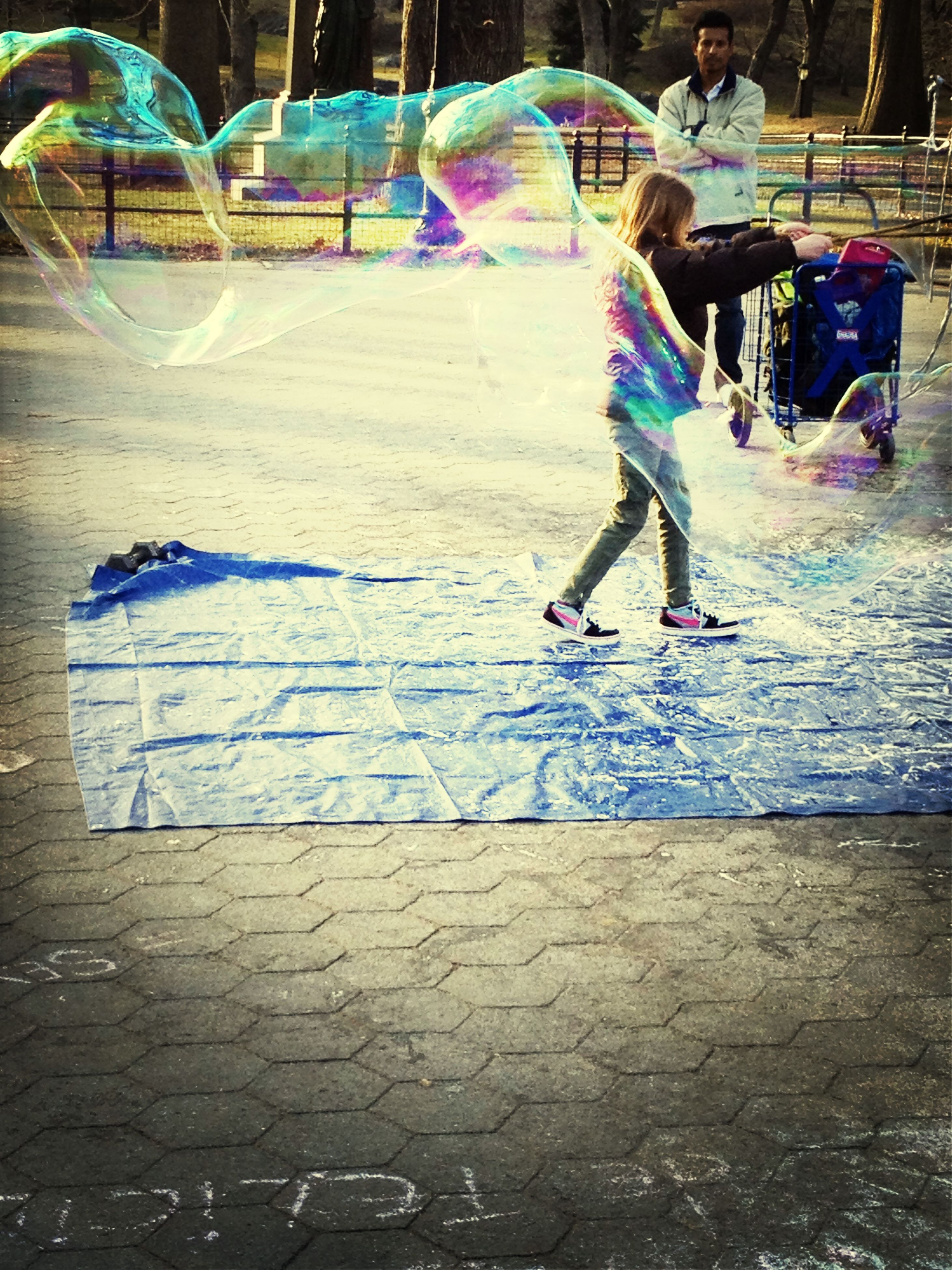 lifestyles, full length, leisure activity, childhood, boys, casual clothing, men, elementary age, girls, fun, street, enjoyment, playing, walking, person, skill, playful