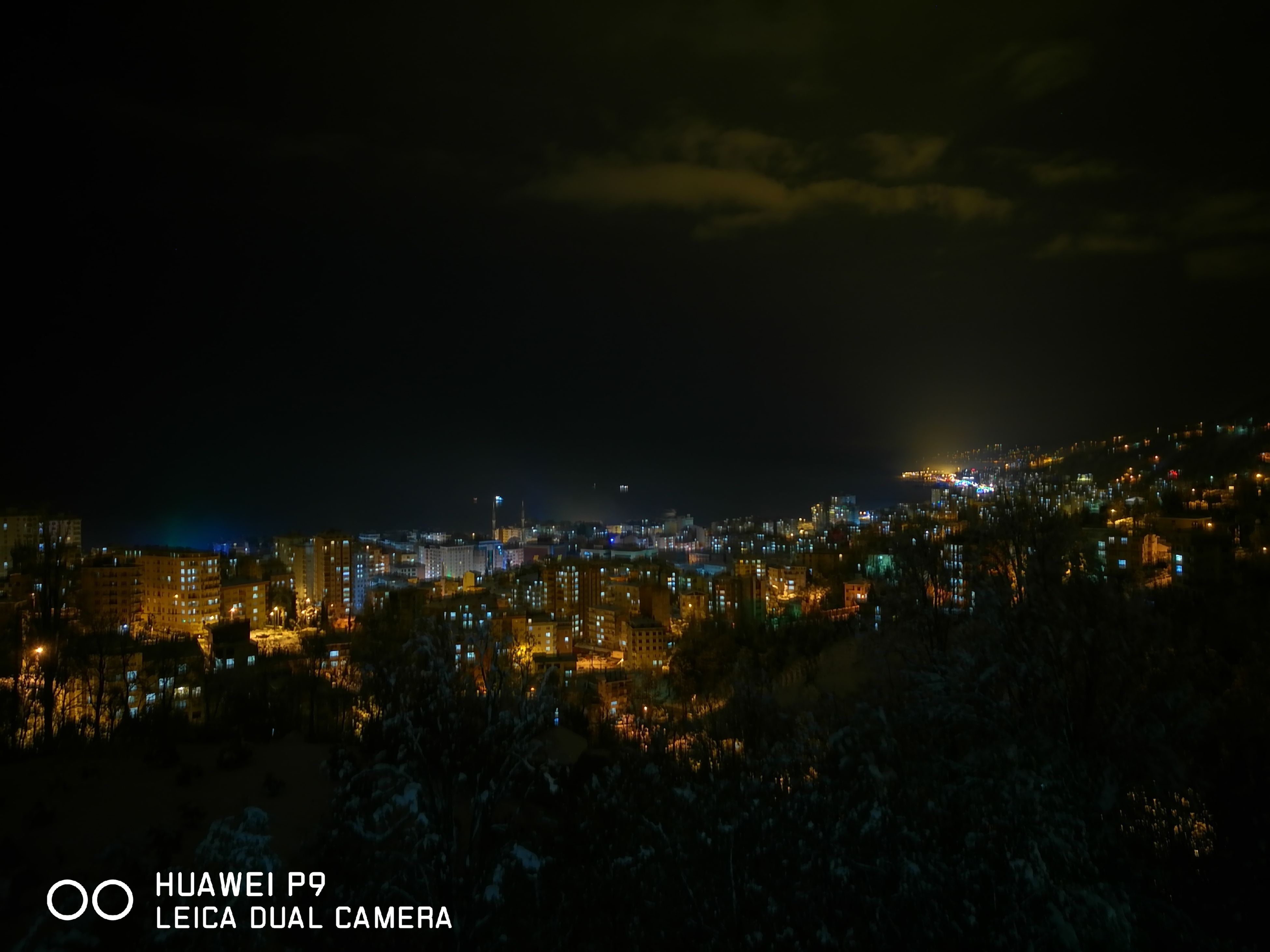 cityscape, city, illuminated, night, building exterior, architecture, crowded, high angle view, built structure, residential district, sky, outdoors, skyscraper, urban skyline, mountain