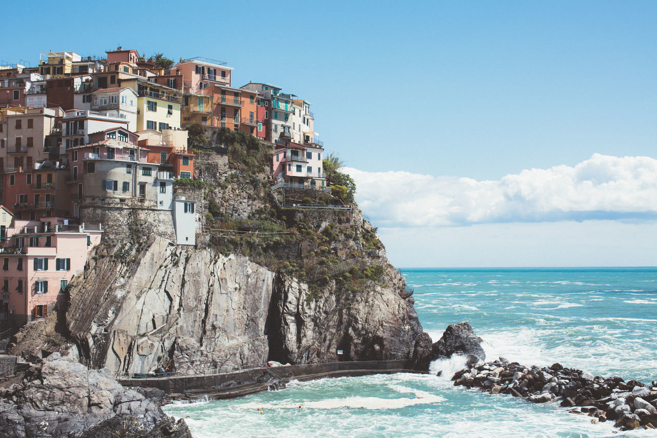 Architecture Beach Beauty In Nature Blue Building Exterior Built Structure Clear Sky Cliff Day Horizon Over Water Italy Nature No People Outdoors Rock - Object Scenics Sea Sky Travel Destinations Water