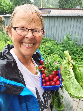 Harvesting at a rainy day Senior Adult Eyeglasses  Smiling Vegetable Portrait Looking At Camera One Person Mature Adult Mature Women Adult Outdoors Women Lifestyles Adults Only Healthy Eating Happiness Senior Women One Senior Woman Only Only Women One Woman Only Tomato Salad Harvesting Rainy Days