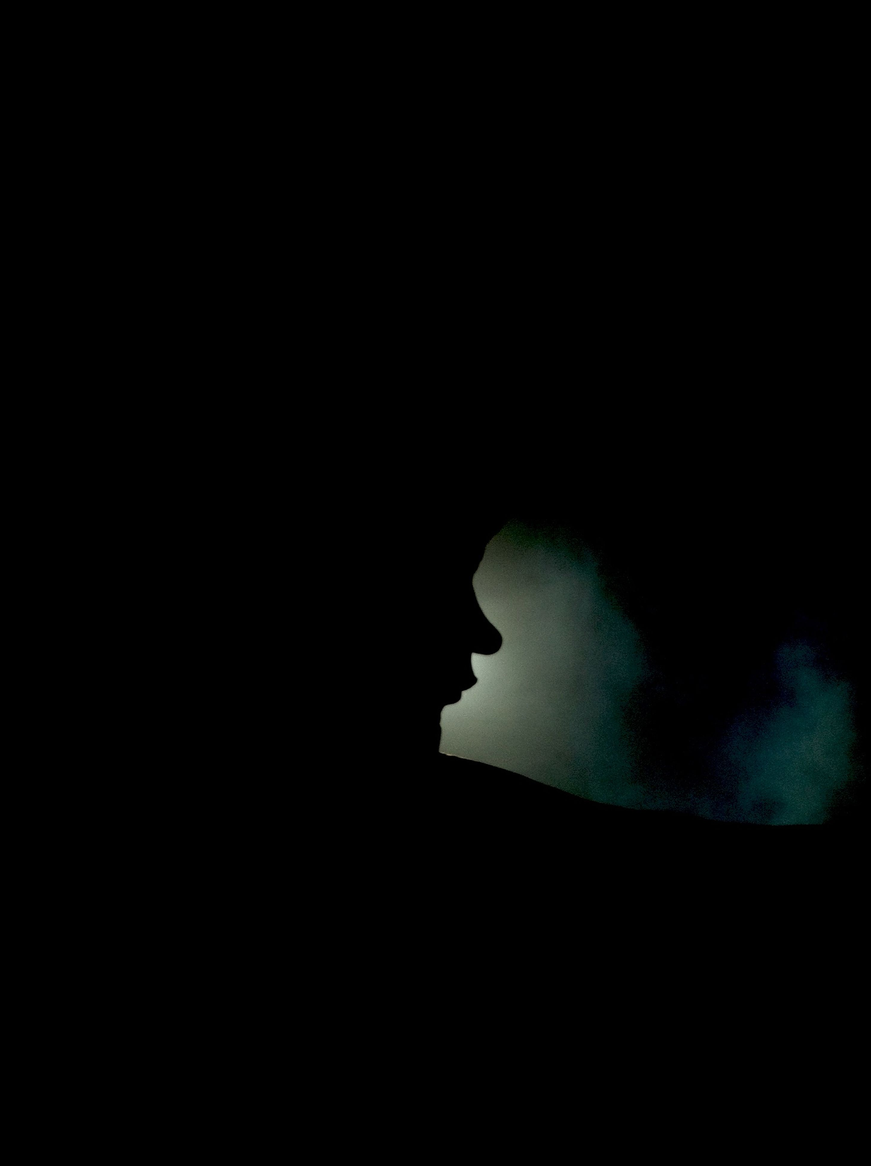 dark, copy space, silhouette, night, indoors, low angle view, darkroom, darkness, outline, one person, mystery, light - natural phenomenon, sky, black background, moon, clear sky, tranquility, illuminated, black
