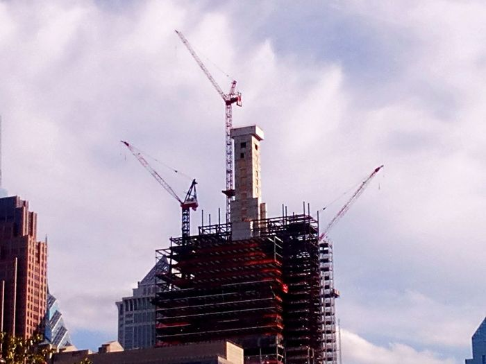 Low Angle View Architecture Building Exterior Development Construction Site Crane - Construction Machinery High Section Tall Progress Tall - High No People City Life City Tower Sky Low Angle View Architecture Built Structure Comcast Tower 2