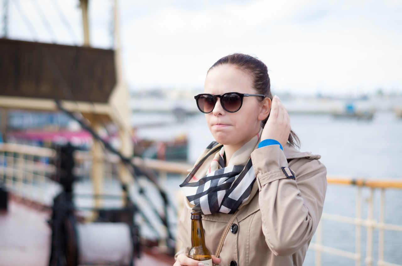 Wandering on a hundred years old Icebreaker (Suur Tõll), gazing at the old-fashioned but elegant living rooms, and thrill-seeking in the gloomy lower decks of machinery. Autumn Casual Clothing Drinking Beer Focus On Foreground Girl Leisure Activity Lifestyles On A Ship Outdoors Overcoat Port Portrait Scarf Serious Girl Sunglasses Teenager