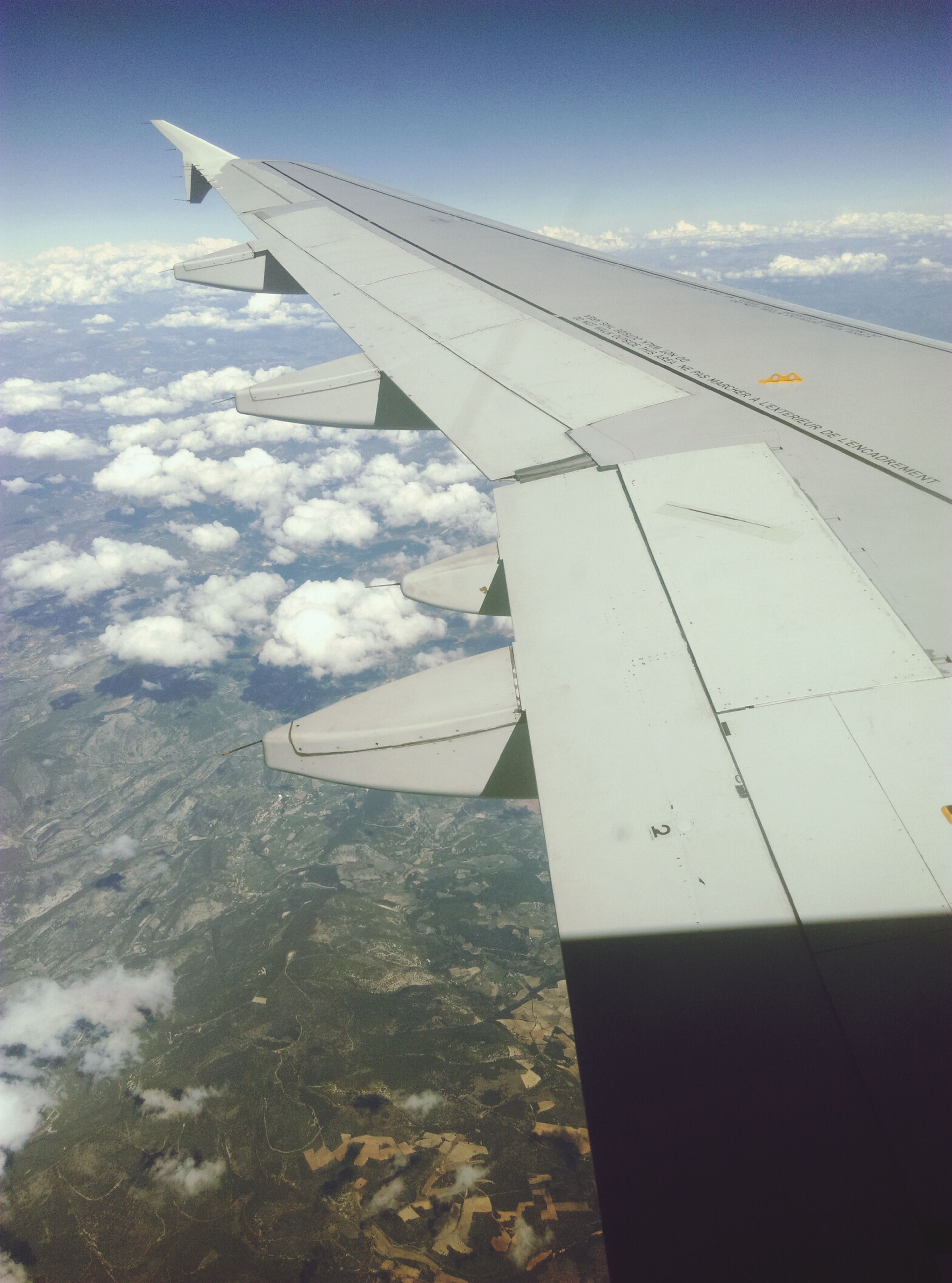 aircraft wing, airplane, flying, air vehicle, transportation, mode of transport, cropped, part of, sky, mid-air, aerial view, travel, landscape, journey, cloud - sky, airplane wing, public transportation, scenics, nature, beauty in nature