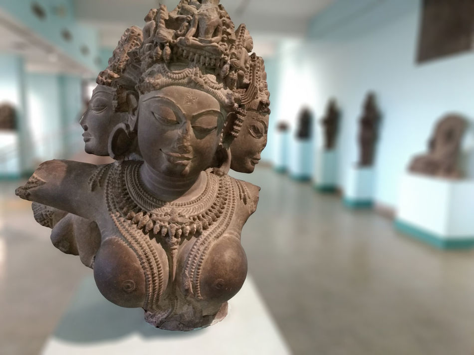 """Put your imagination into reality and you will create something beautiful - ✍Code Nemesis✍ This sculpture of Tara or also known as Jetsun Dölma was made in 11th century AD. Tara is the female Buddha in Vajrayana Buddhism. She is known as the """"mother of liberation"""", and represents the virtues of success in work and achievements. Each head shows a form of Tara. Most widely known forms of Tara are : GREEN TARA known as the Buddha of enlightened activity WHITE TARA, also known for compassion, long life, healing and serenity RED TARA, of fierce aspect associated with magnetizing all good things BLACK TARA, associated with power YEllOW TARA associated with wealth and prosperity BLUE TARA, associated with transmutation of anger. Art Carving - Craft Product Craft Creativity Focus On Foreground Sculpture Statue Hanging Out History Historical Monuments Historical Building Historical Place Meusem Enjoying Life Capture The Moment Eye4photography  From My Point Of View Taking Photos Taking Pictures Showcase July EyeEm Best Shots Check This Out Sclupture No People Perspective"""