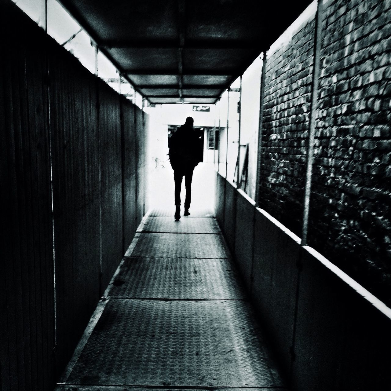 full length, walking, rear view, tunnel, one person, the way forward, real people, architecture, men, built structure, standing, indoors, day, adult, people