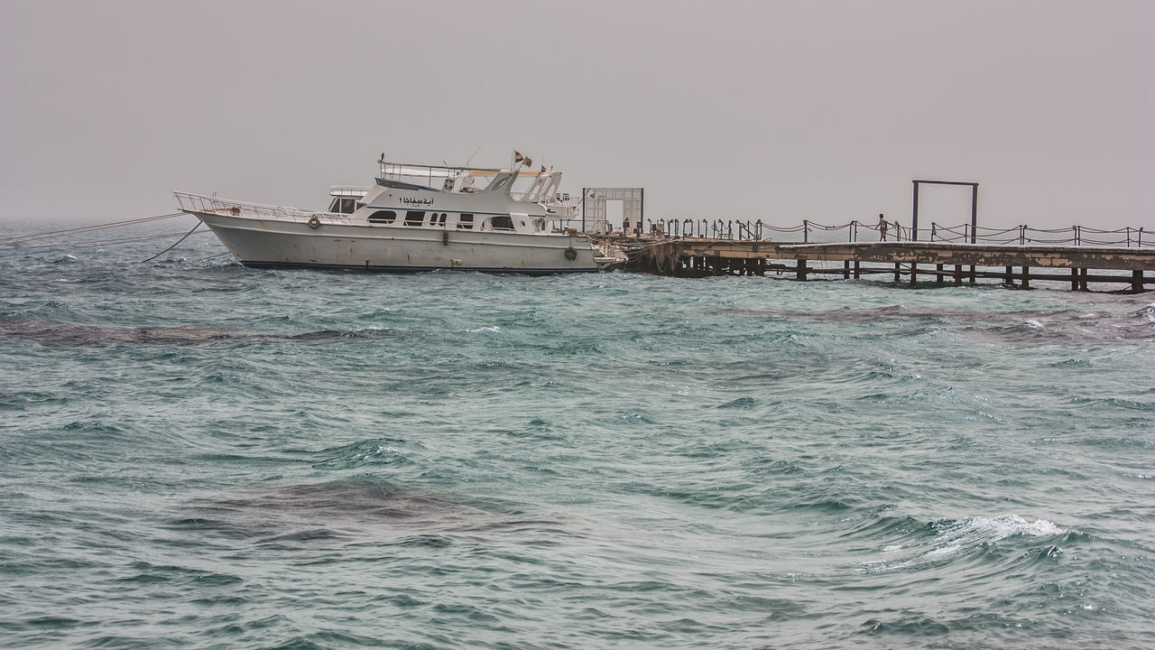 Boat Boat Dock Day Nautical Vessel Outdoors Sea Sky Swelling Transportation Water Wave Weather Windy Day