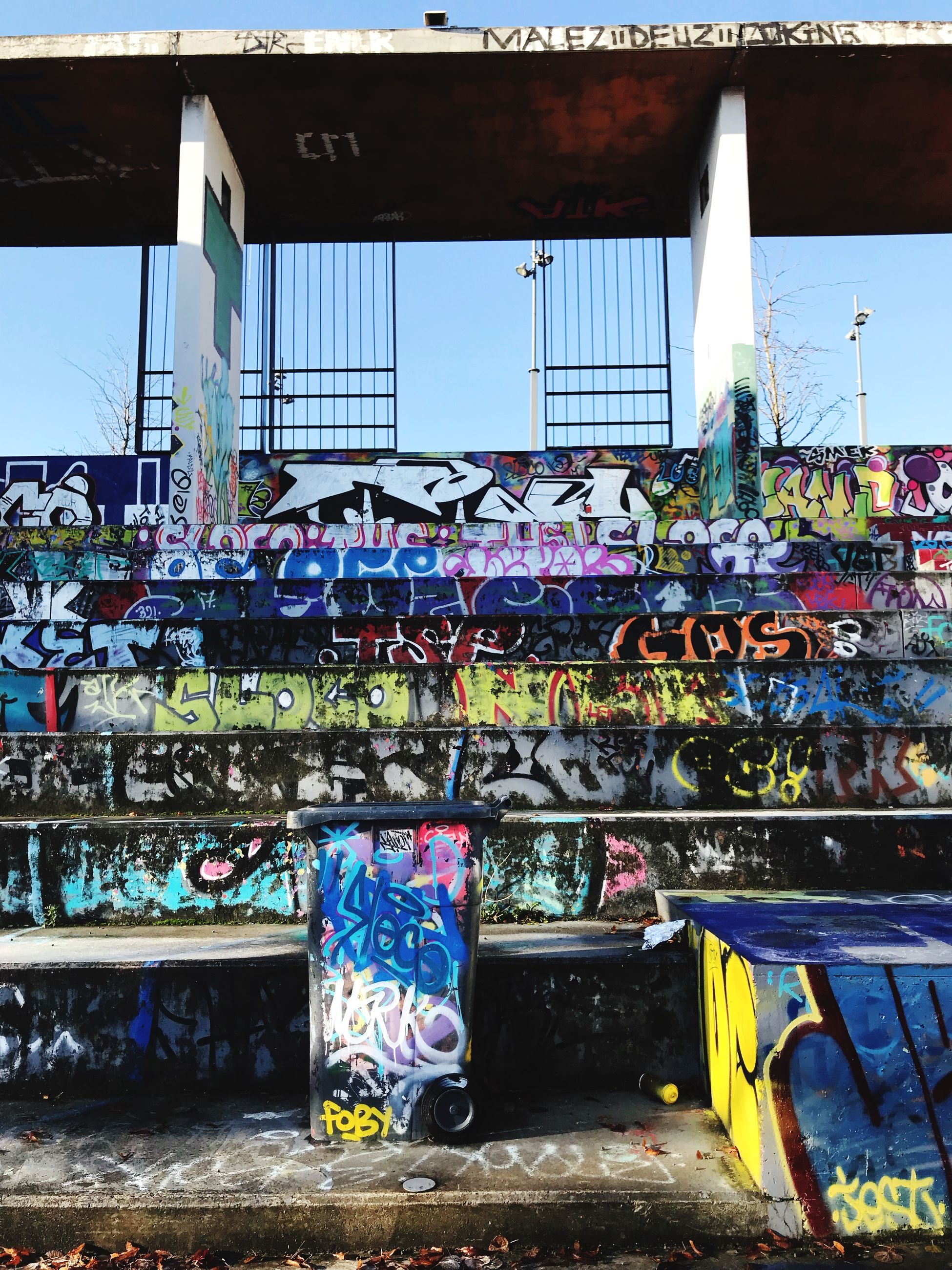 graffiti, text, day, built structure, architecture, outdoors, no people, multi colored, communication, building exterior, sky, city