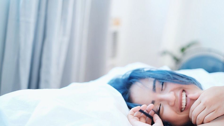 Blue Valentine Bed Indoors  One Person Lying Down Real People Home Interior Close-up Lifestyles Human Hand Bedroom Young Adult Day Young Women Human Body Part People