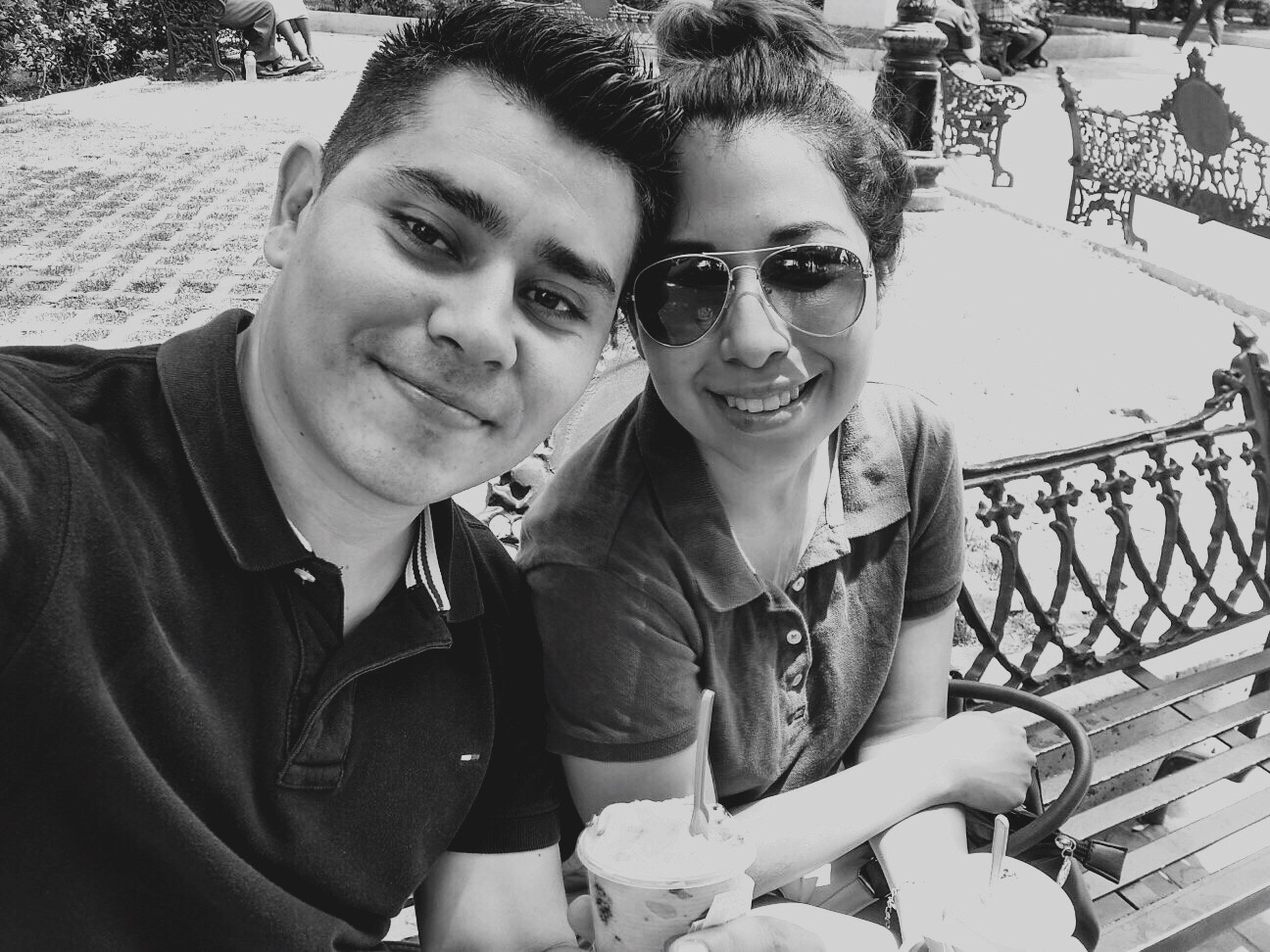 two people, looking at camera, portrait, togetherness, smiling, love, happiness, sitting, real people, men, day, bonding, young women, young adult, outdoors, friendship, people