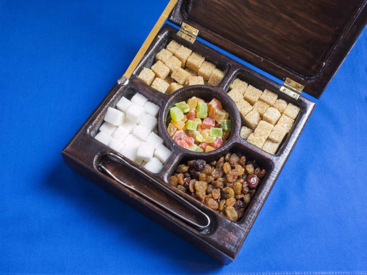 tea box with various kinds of sugar, candied fruits and raisins Blue Box Candied Close-up Day Food Food And Drink Freshness Fruits Healthy Eating High Angle View Indoors  Kinds No People Raisins Ready-to-eat Sugar Tea Various Wood Wooden