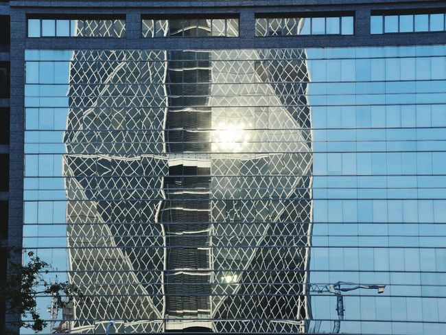 The building reflects the opposite China Steel Corporation Headquarters. Built Structure Architecture Structure Reflection Window Sunlight Sunset Abstract China Steel Corporation Headquarters Kaohsiung Building Mirror