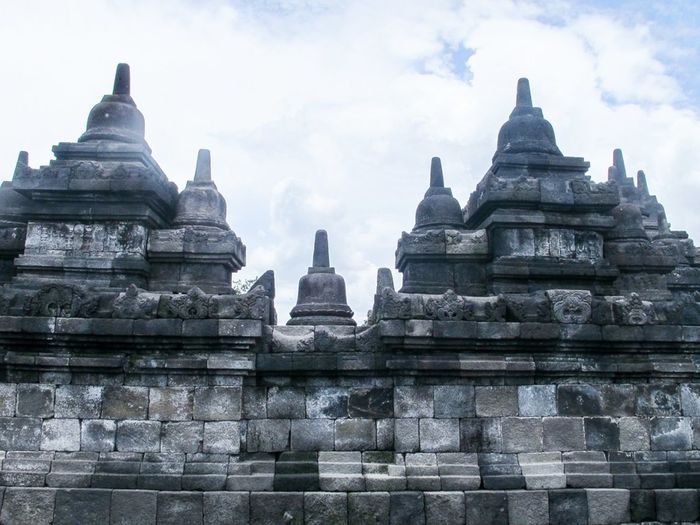Ancient Ancient Civilization Architectural Feature Architecture Borobudur Temple Building Exterior Built Structure Day Famous Place History No People Place Of Worship Prambanan Temple Religion Sky Spire  Spirituality Stone Material Stupa Tall Temple Temple - Building The Past Tourism Travel Destinations