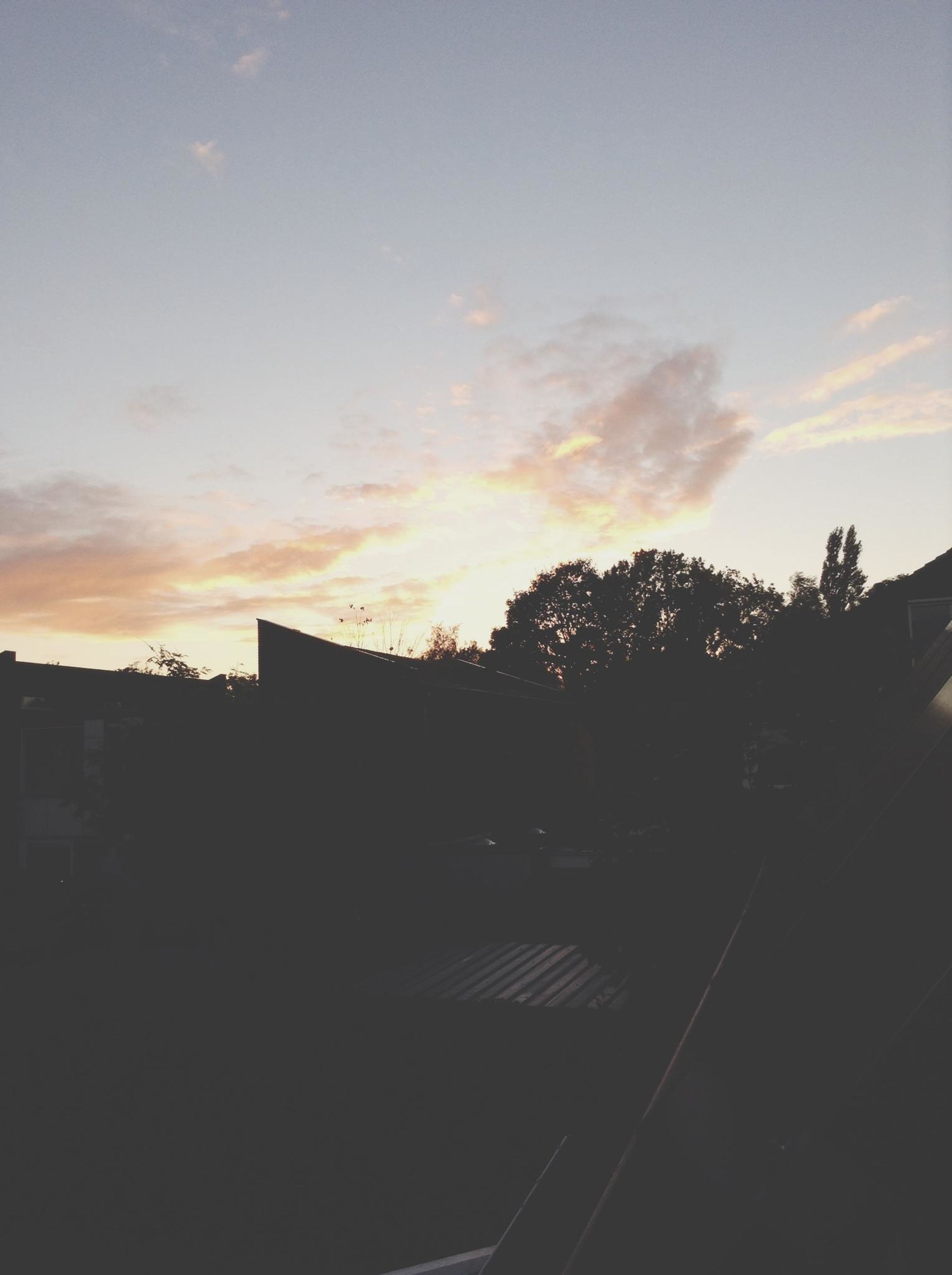 sunset, silhouette, sky, building exterior, built structure, architecture, tree, house, orange color, cloud - sky, low angle view, residential structure, dusk, nature, beauty in nature, cloud, outdoors, no people, roof, residential building