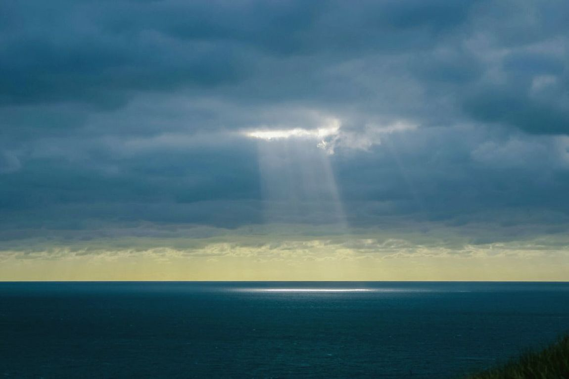 Shaft of Light Series Shaft Of Light Series Beam Of Light Breaking Through  Clouds Dark Clouds England Light Ray Of Light Sea Shaft Shaft Of Light Shimmer Spotlight Uk Sunbeam Sunlight Water Faith Hope New Beginning Atmospheric Mood Dramatic Sky Cloudscape Dorset Perspectives On Nature See The Light