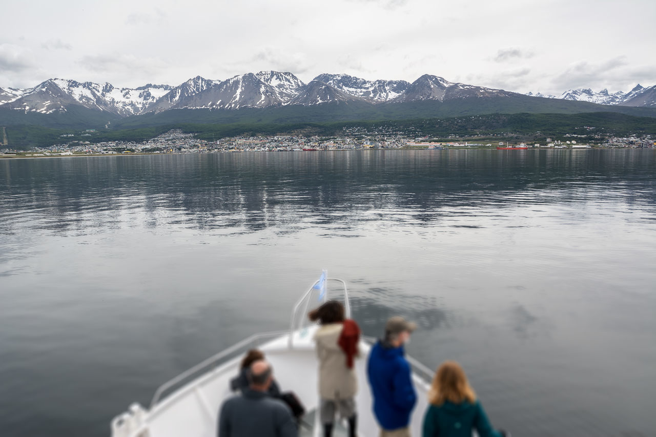 Ushuaia viewed from boat in Beagle channel (Argentina) Argentina Beagle Channel Boat Bow Coast Land Of Fire Landscape Mountain People Sea Snowcapped Tierra Del Fuego Travel Destinations Ushuaïa Water