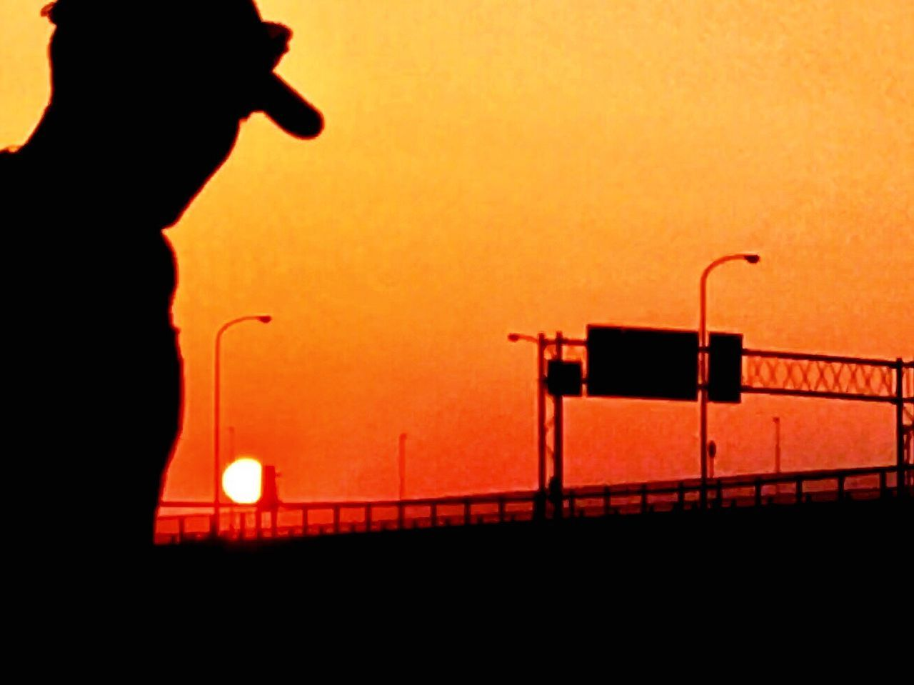 Sunset Runner Silhouette Standing One Person Sky Outdoors Clear Sky People One Man Only Adult Adults Only Day The Street Photographer - 2017 EyeEm Awards EyeEmNewHere The Portraitist - 2017 EyeEm Awards