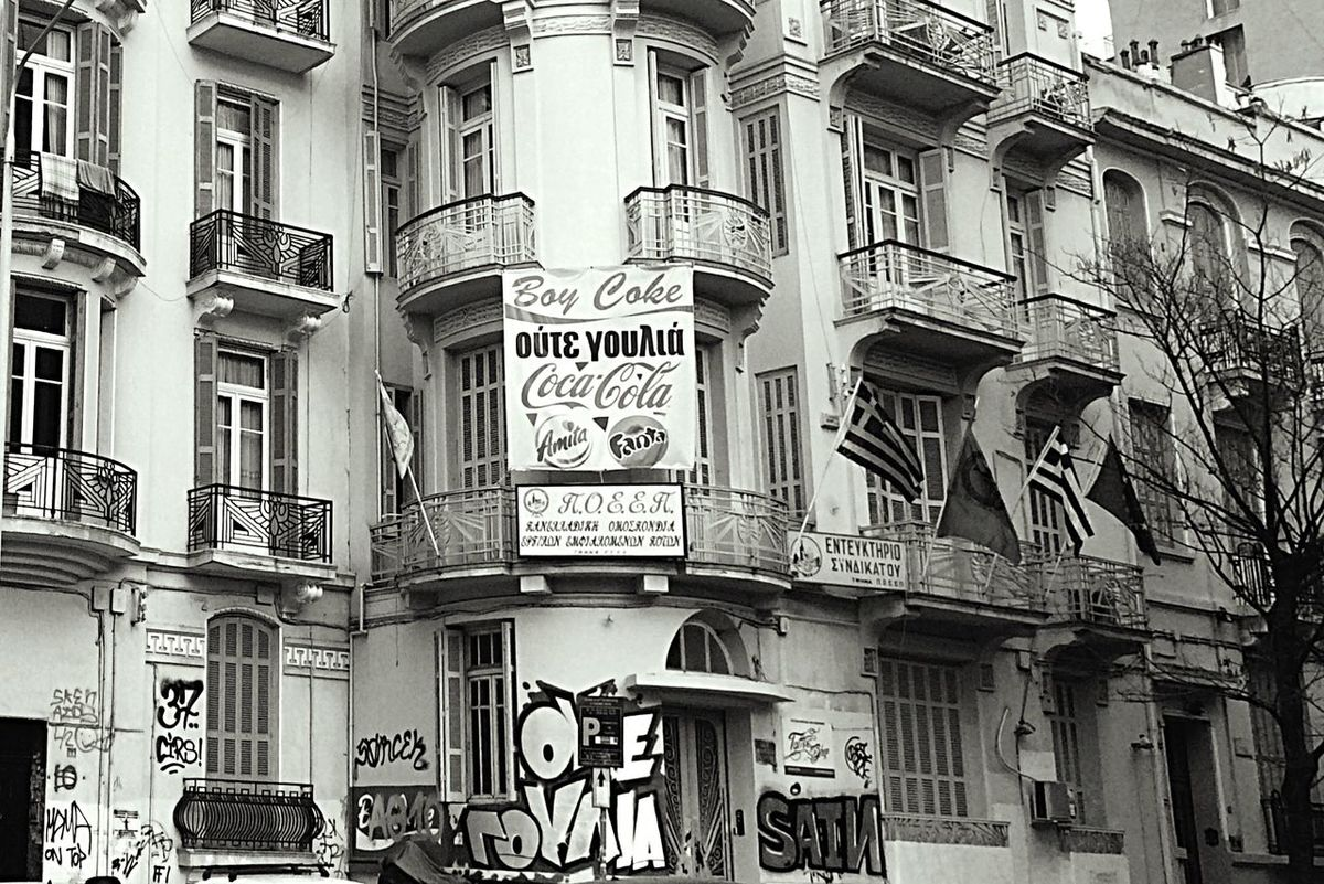 Architectural Detail with Poster & Flags Letters In The City Bwn_friday_eyeemchallenge Blackandwhite City Center Urban Geometry Urbanexploration No People Graffiti Art in Old Buildings Thessaloniki Bnw_friday_eyeemchallenge