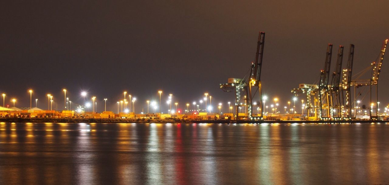 Southampton Docks Nearby Aroundyou Illuminated Waterfront Night Water River City Reflection Sky Dark Sea Electric Light Multi Colored Commercial Dock Outdoors Ocean Tall Scenics Development City Life Harbor